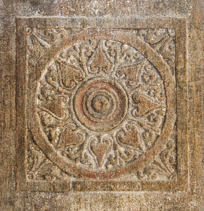 Stone Chakra. A chakra carved into a ancient temple wall stock image
