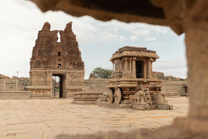 Stone chariot in courtyard of Vittala Temple in Hampi, Karnataka, India.  royalty free stock photo