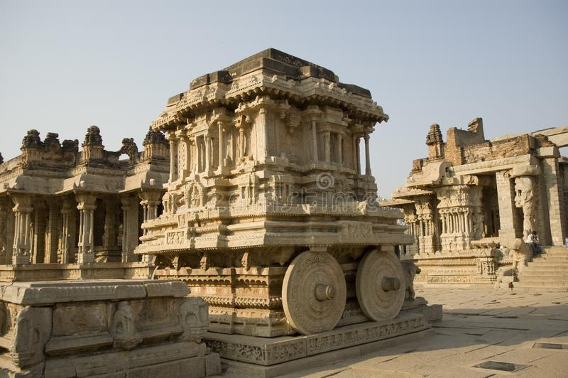 Stone chariot in courtyard of Vittala Temple at sunset in Hampi, Karnataka, India stock photos