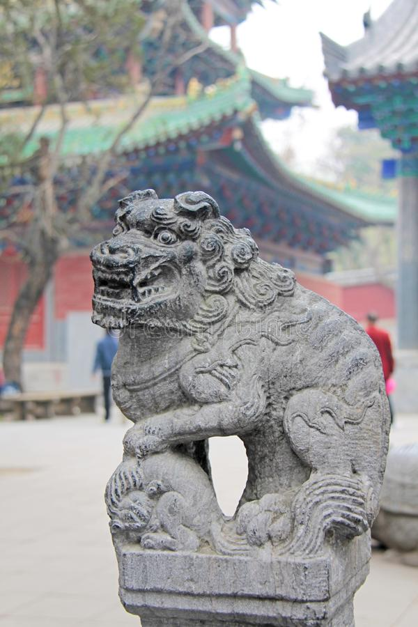 Stone Chinese lion in the monastery of Shaolin, China stock photo