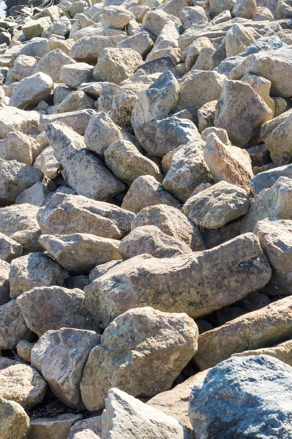 Stone chippings at the riverside royalty free stock photos
