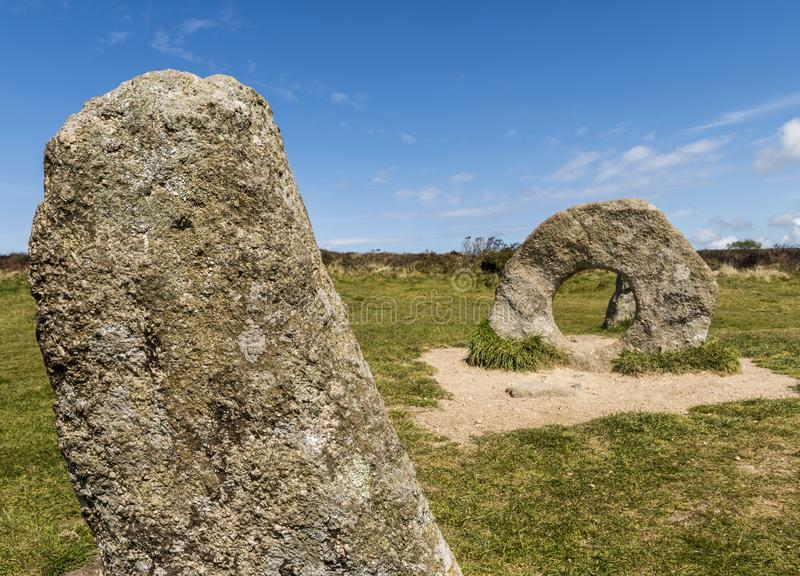 Stone Circle Men-an-Tol. `Stone Circle` Men-an-Tol with three standing stones on a meadow in Cornwall, England stock images