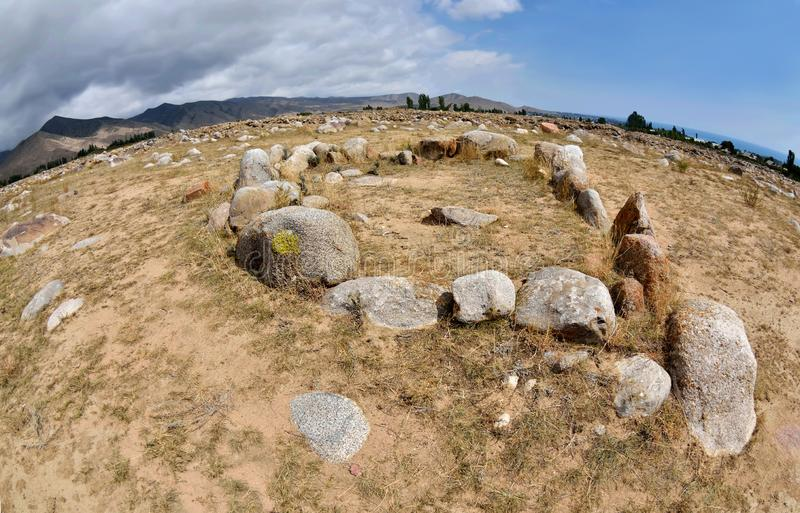 Stone circles in Cholpon Ata open air museum with ancient rock paintings, Issyk-Kul lake shore, Kyrgyzstan,Central Asia,unesco her royalty free stock images