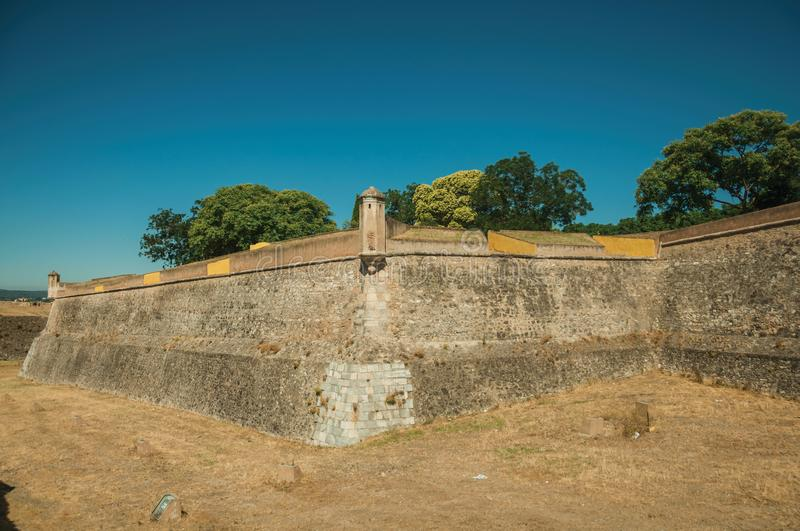 Stone city wall corner with watchtower and dry moat stock photos