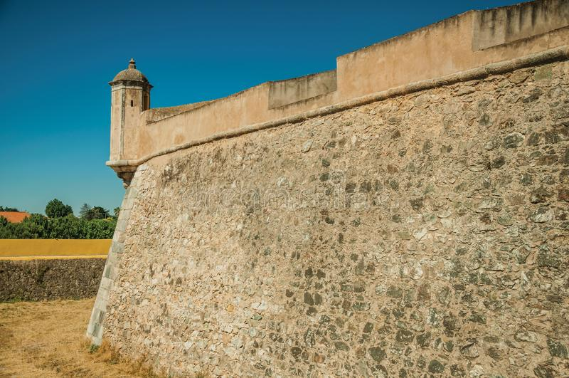 Stone city wall corner with watchtower and dry moat stock images