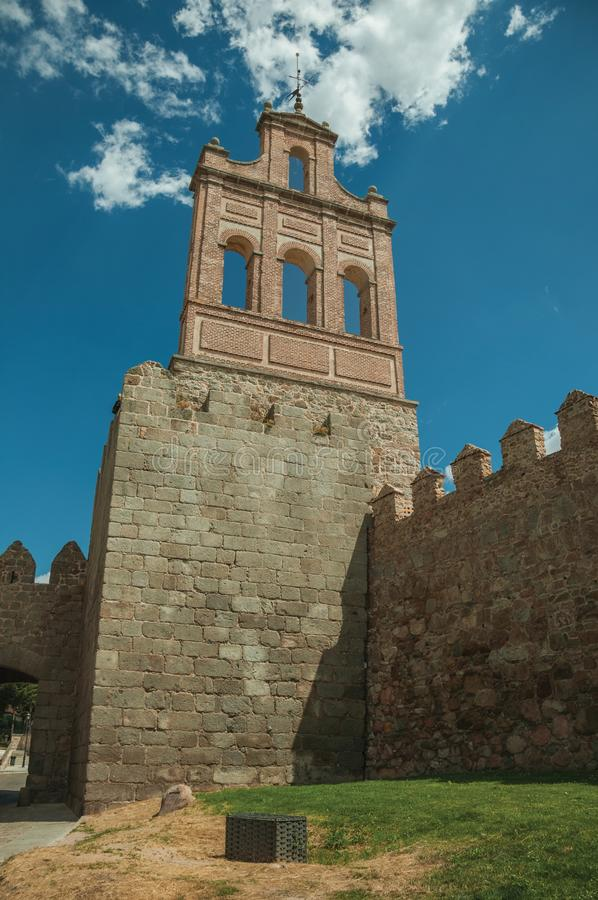 Stone city wall and tower made by bricks in Avila stock images