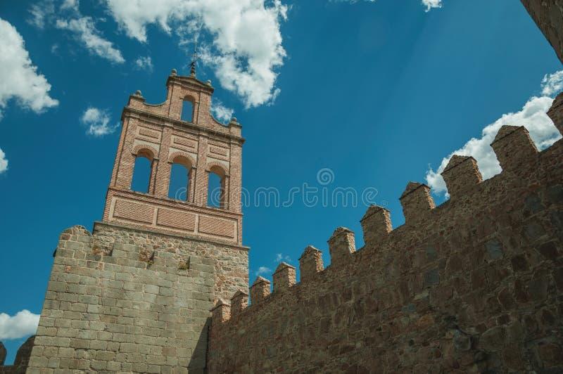 Stone city wall and tower made by bricks in Avila royalty free stock photo