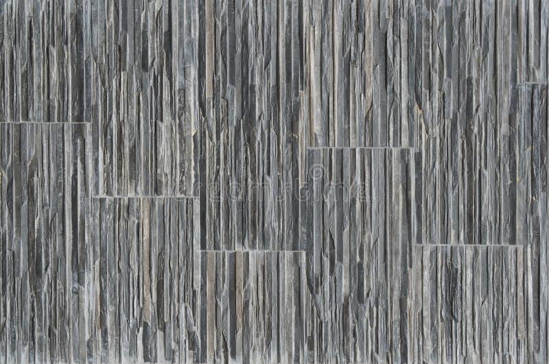Stone cladding made of gray shades stripes for exterior walls . stock photos