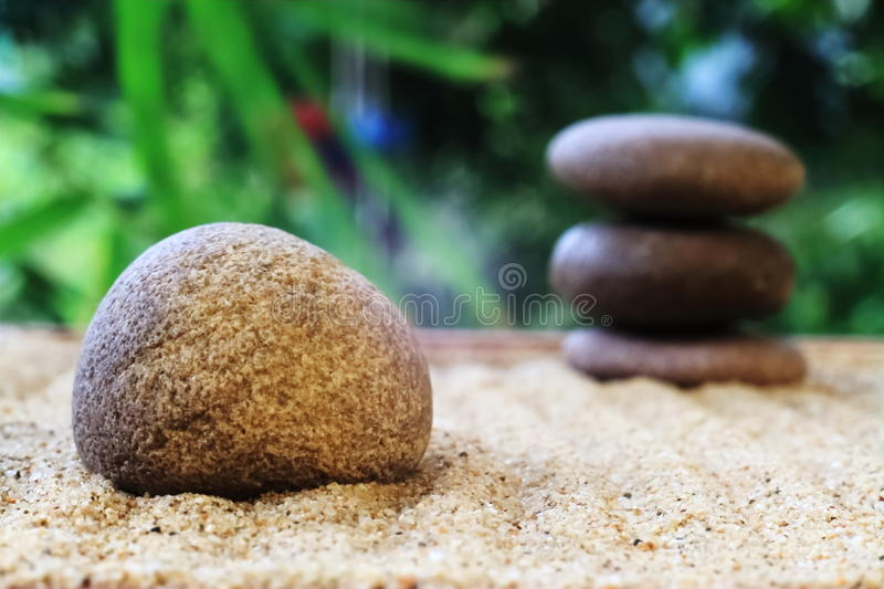 Zen stacked stones on nature background royalty free stock images