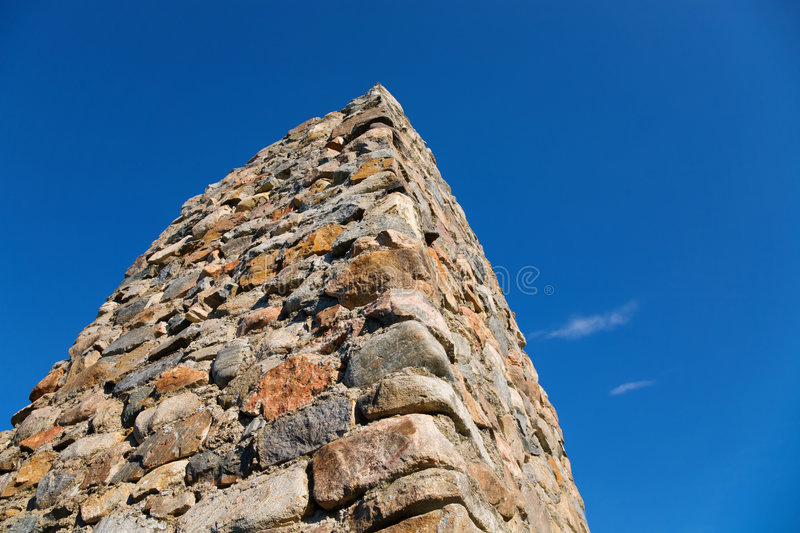 Stone column. On a background of the blue sky royalty free stock images