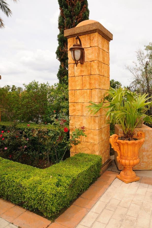 Stone column in a garden stock photography