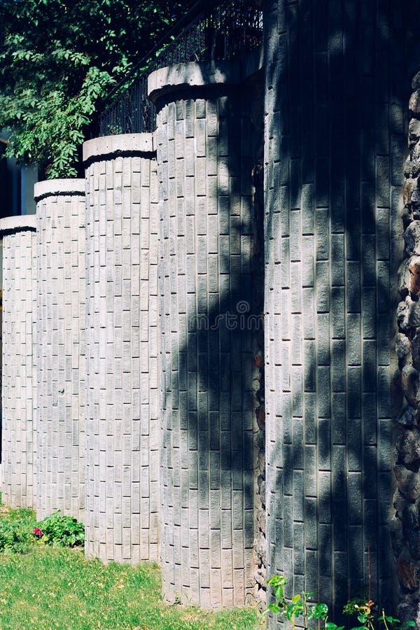 Stone column in the garden. Stone column fence royalty free stock image