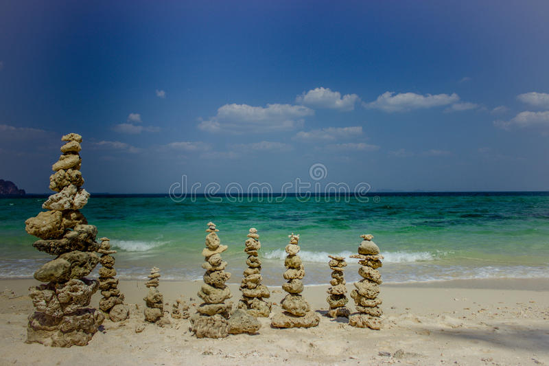 Stone columns on the sea coast royalty free stock photography