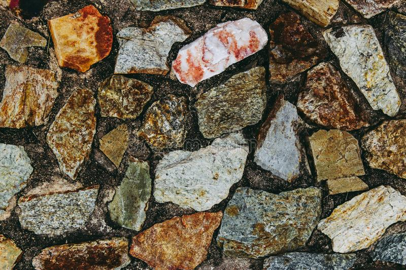 Stone in concrete wall for background. in dark tone. stock image
