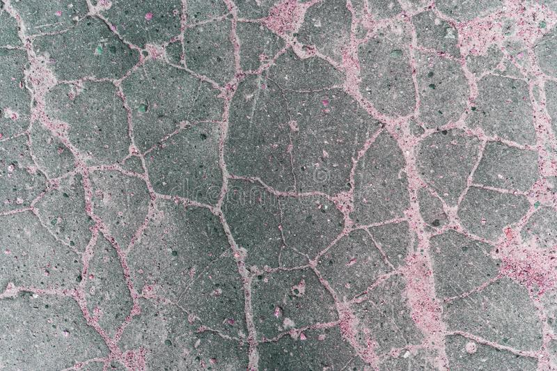 Stone cracked surface of gray, pink tones. Old stone floor.  royalty free stock images