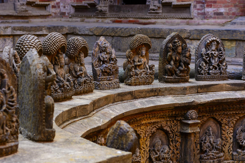 Stone crafted gods in Lalitpur Nepal. Stone crafted gods surrounding the sacred temple in lalitpur Nepal royalty free stock photos
