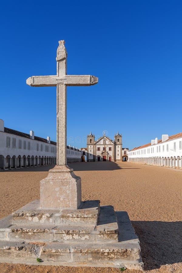 Stone Cross, Church and Pilgrim lodgings of Santuario de Nossa Senhora do Cabo Sanctuary. stock photography