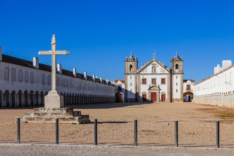 Stone Cross, Church and Pilgrim lodgings of Santuario de Nossa Senhora do Cabo Sanctuary. royalty free stock photo