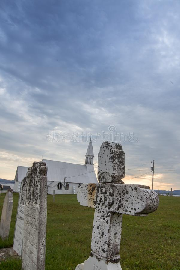 Graveyard in Gaspe Quebec. Stone cross in a graveyard in Gaspe Quebec stock photos