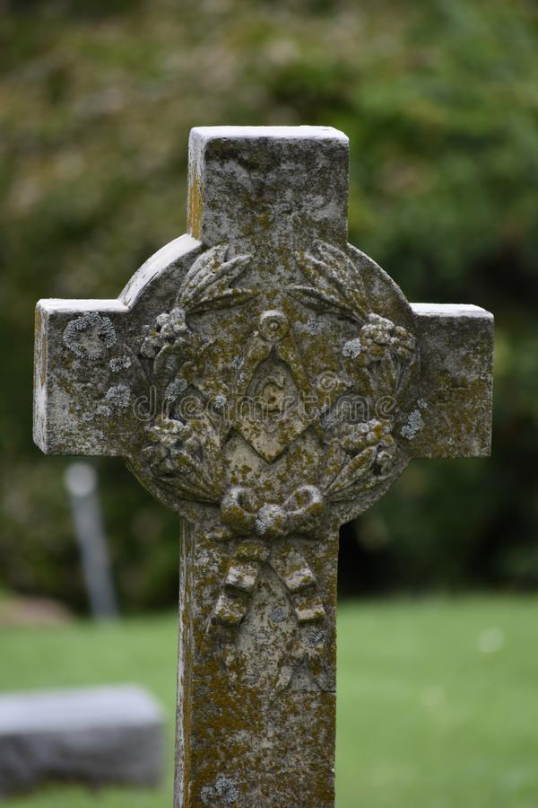 Stone cross in Oakwood Cemetery in Fort Worth Texas royalty free stock photos