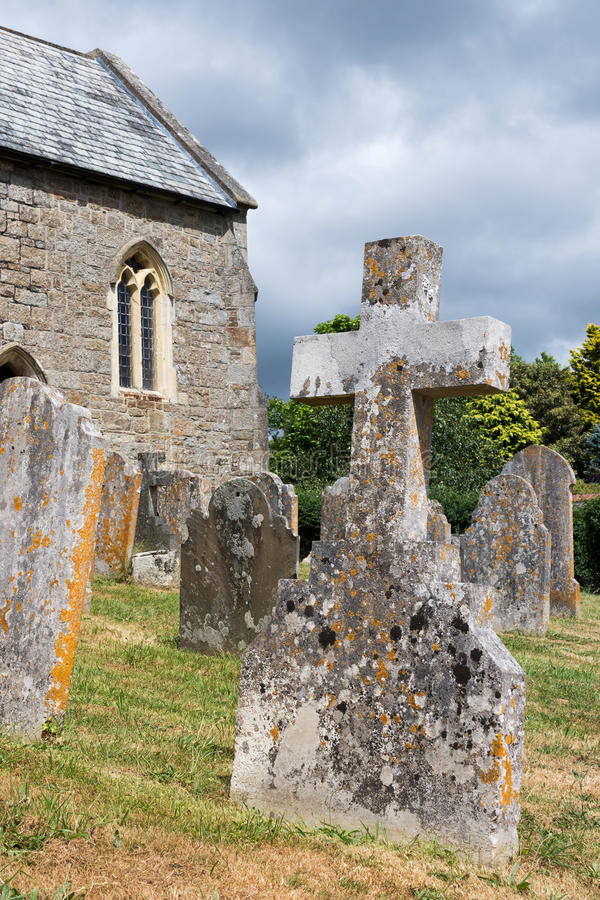 Stone cross tombstone in graveyard royalty free stock photo
