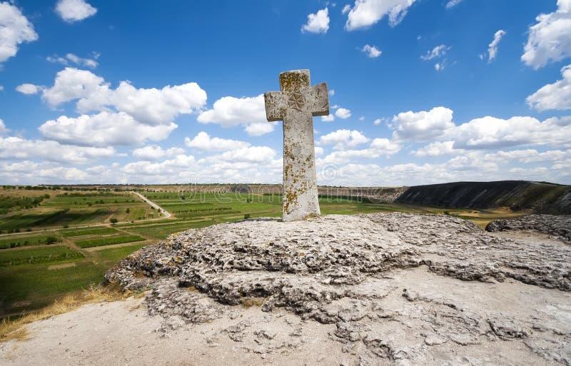 Stone cross under blue sky royalty free stock photos