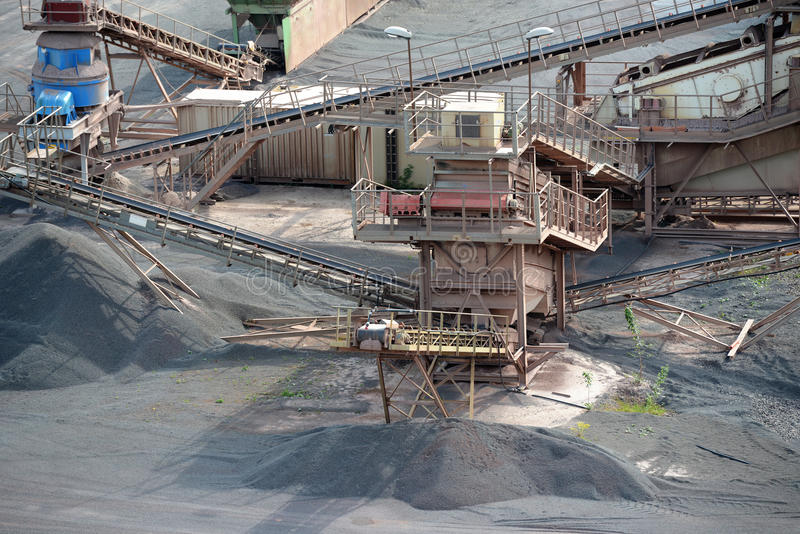 Stone crusher machine in an open pit mine. mining industry.  royalty free stock images