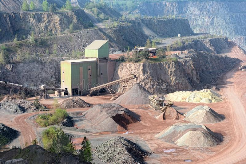 Stone crusher machine in a open pit mine. Porphyry rock stock image