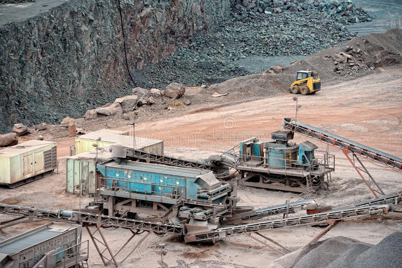 Stone crusher in a quarry mine of porphyry rocks stock image