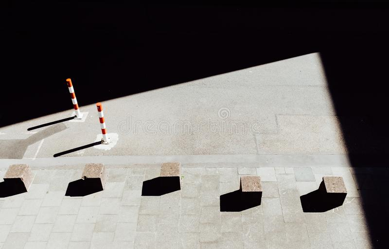 Stone cubes on pavement. A bird`s eye view of stone cubes and their shadows on a pavement royalty free stock photos