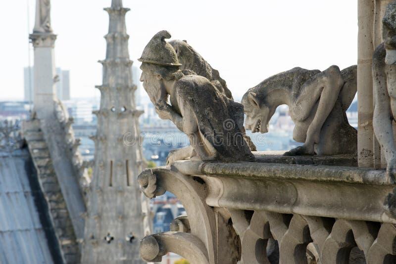 Stone demons gargoyle on the Notre Dame - Paris stock photos