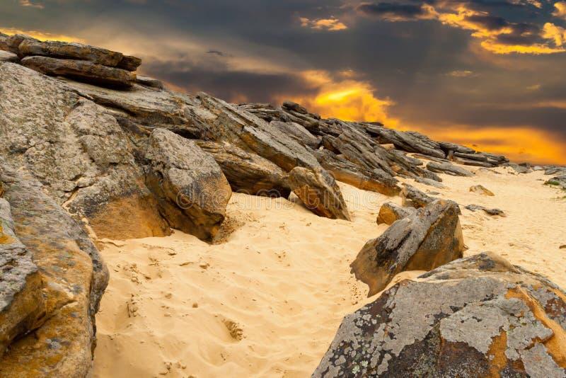 Stone desert on fantastic sunset background . stock photos