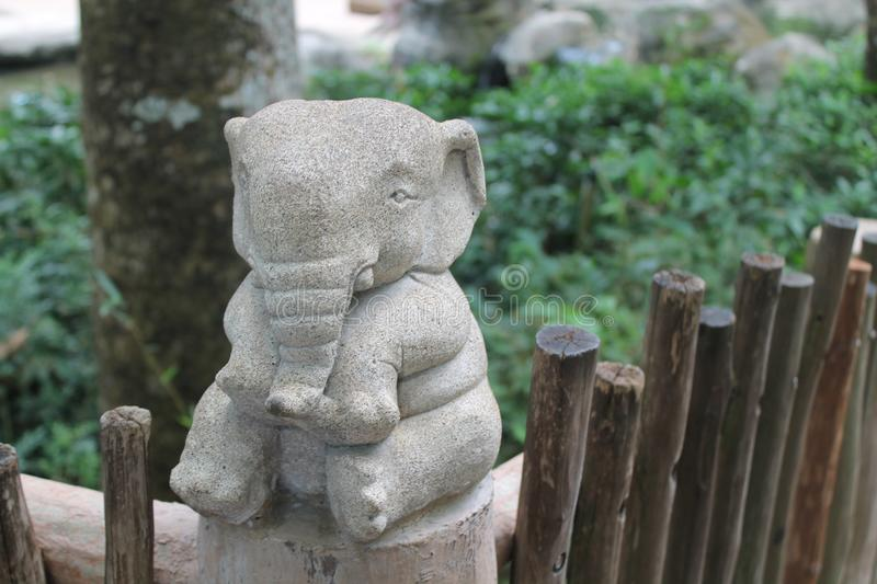 Stone elephant statue on nature background, front view, Clipping stock photo
