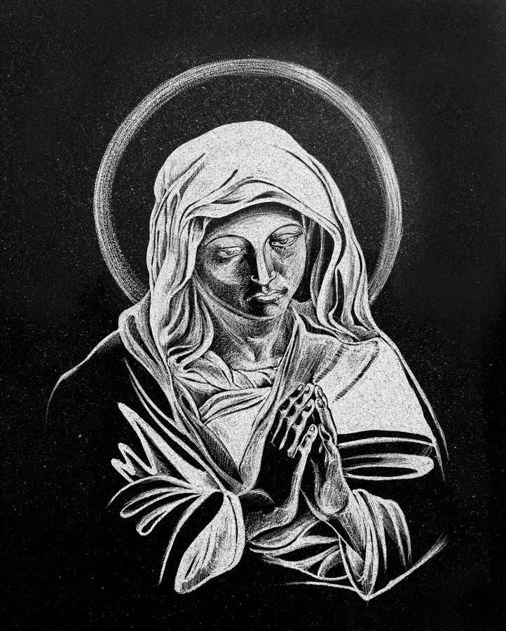 Stone engraving of Virgin Mary stock photo