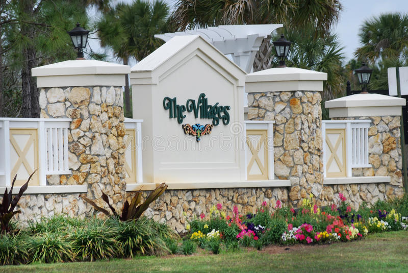 Stone entrance sign to The Villages in Florida in spring. royalty free stock photo