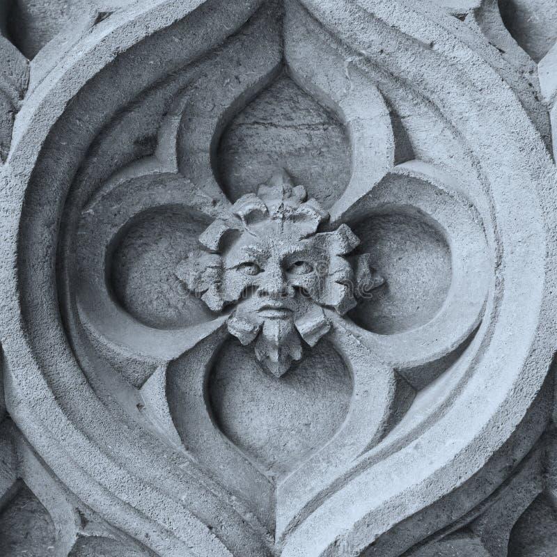Stone face. A photography of an old stone face stock photos