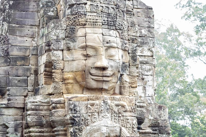 Stone face ruin of ancient buddhist temple Bayon in Angkor Wat complex, Cambodia. Ancient architecture royalty free stock photography