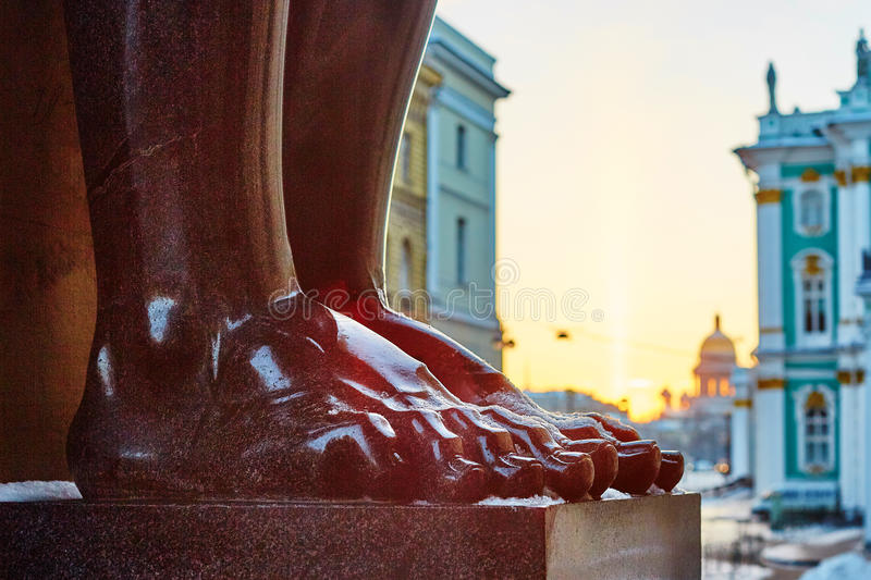 Stone feet of the atlant in Saint Petersburg. Close-up of stone feet of the atlant in Saint Petersburg, Russia stock images