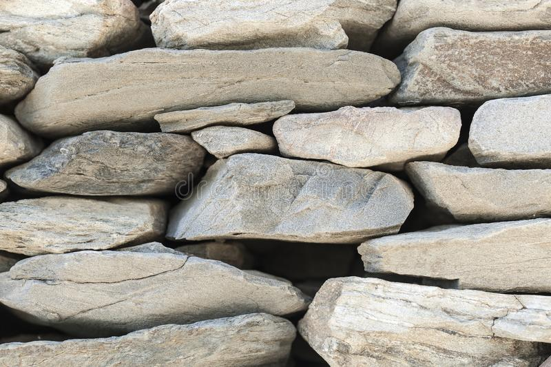 The stone fence of solid pieces of stone.  royalty free stock photos