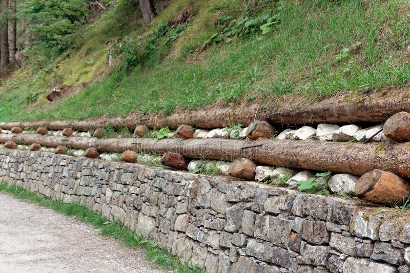 Stone fencing. combining stone and wood for the fence.  royalty free stock photos