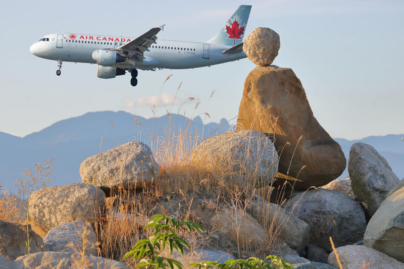 Stone Figure and Air Canada Passenger Jet stock photos