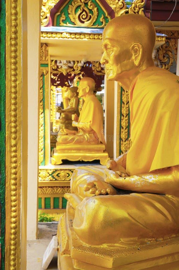Stone figure of a seated Buddhist monk. Wat Laem Suvannaram royalty free stock images