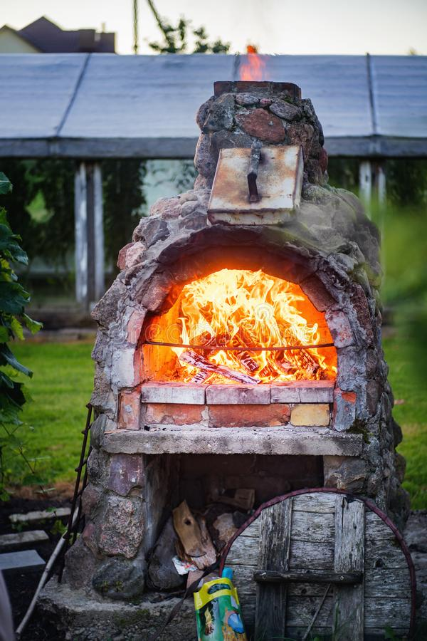 Stone fireplace with fire. In a rural homestead royalty free stock images