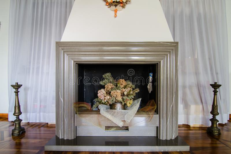 Stone fireplace in living room. With curtains royalty free stock image