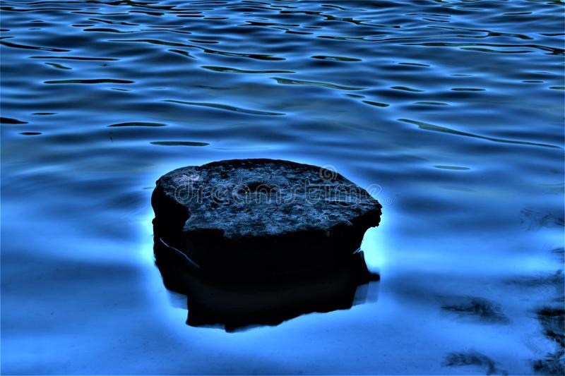 Stone floating on the water stock image