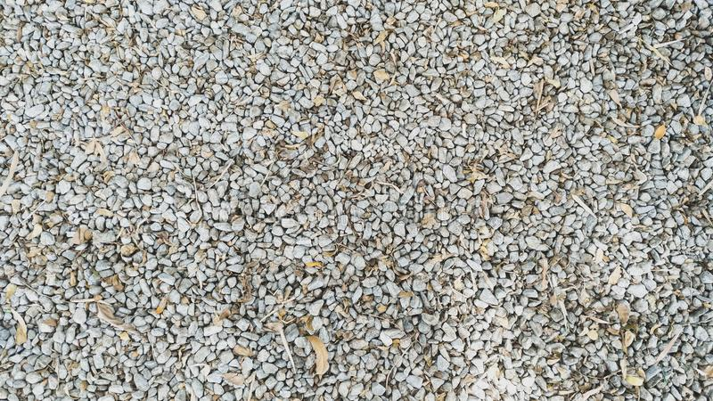 The stone floor and dry leaf texture background stock image