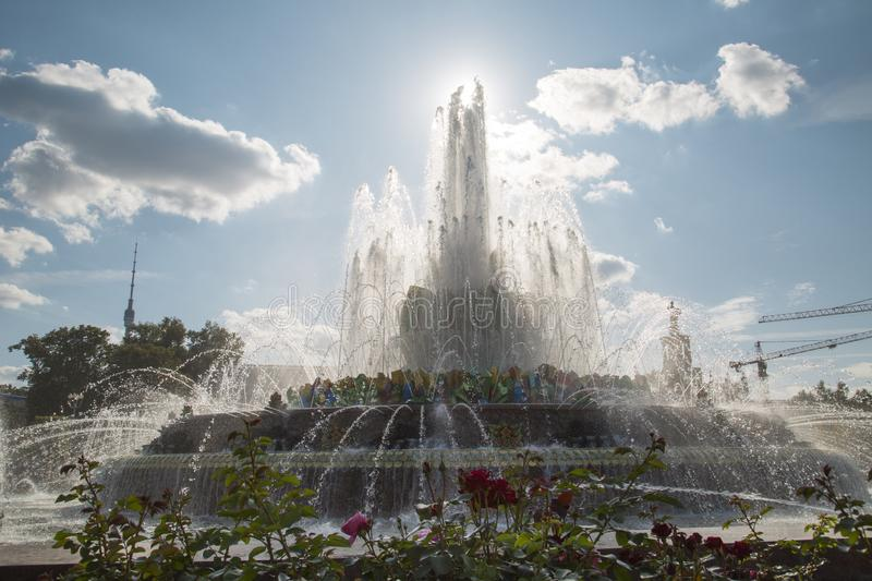 Stone flower fountain at Exhibition of achievements of the national economy VDNH in the contra light on a Sunny day. Moscow attr. Actions of World tourism royalty free stock photo