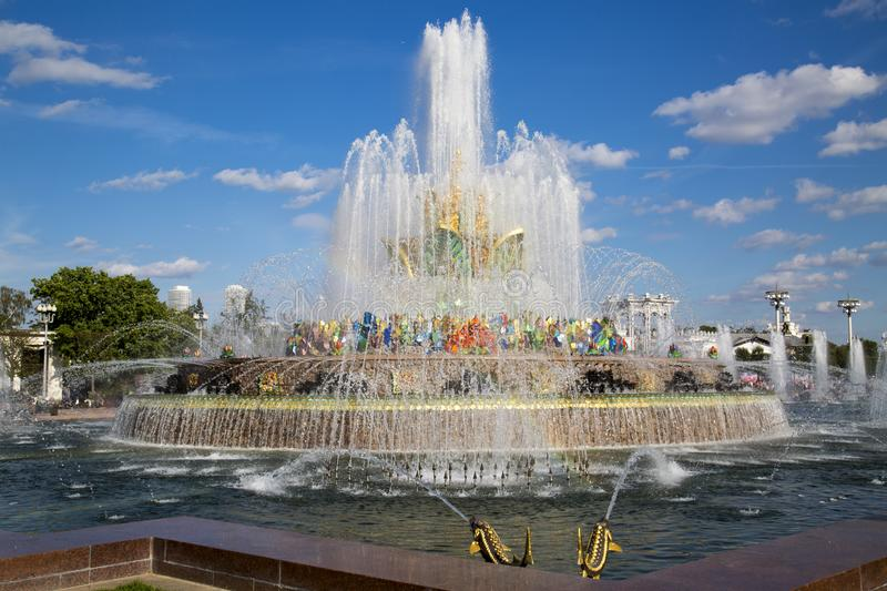 Stone flower fountain at Exhibition of achievements of the national economy VDNH in the contra light on a Sunny day. Moscow attr. Actions of World tourism stock images