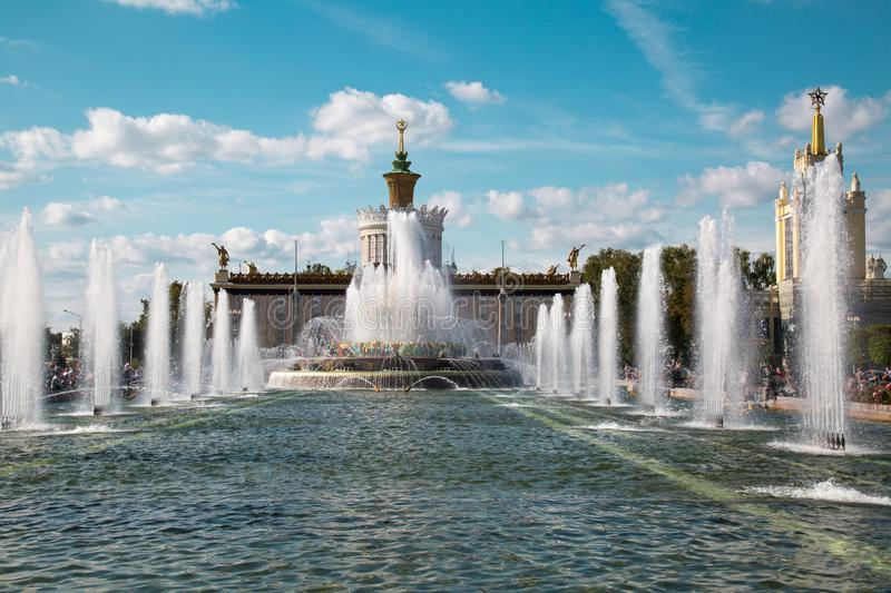 Stone flower fountain at Exhibition of achievements of the national economy VDNH in the contra light on a Sunny day. Moscow attr. Actions of World tourism royalty free stock images