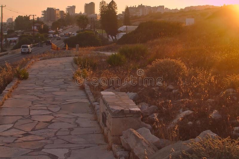 Stone footpath at sunset royalty free stock images